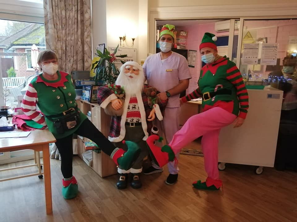 Care Workers celebrating Christmas with Father Christmas